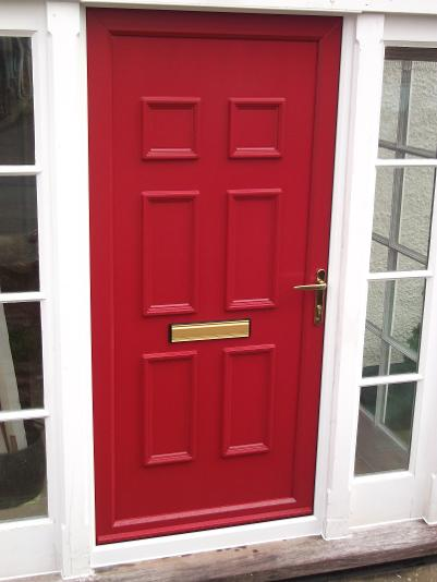 Ruby Red StormMeister Coloured Flood Door giving Automatic Flood Protection